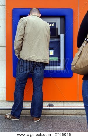 Man Using Cash Machine/ Atm/ Hole In The Wall.