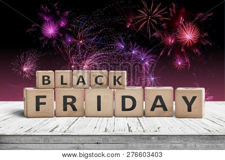 Black Friday Sign On A Wooden Table With Fireworks In The Background On The Annual November 29th Eve