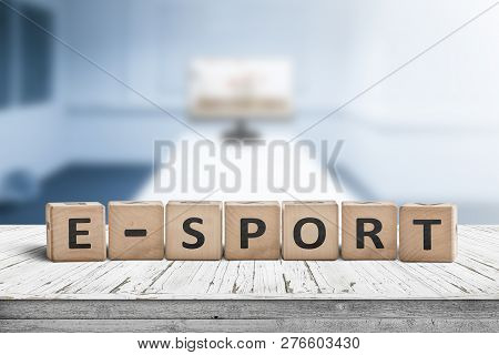 E-sport Sign On A Desk In A Blue Room With A Blurry Background