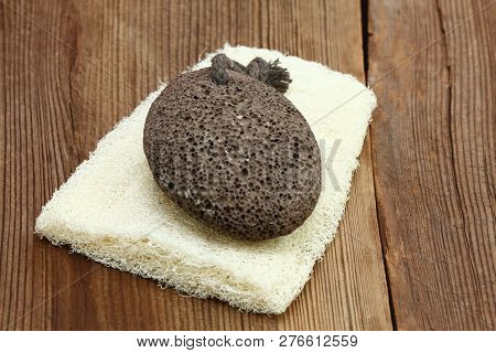 Pumice Stone And Washcloth. Items For Daily Hygiene On The Brown Wooden Board.