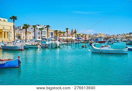 The Coastal Neighborhood Of Marsaxlokk Village, That Is The Popular Tourist Landmark And Joyful Plac