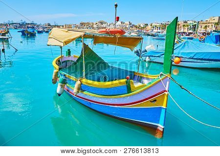 Traditional Luzzu Boat, Made Of Wood And Decorated With Bright Colors And Eye Of Osiris, Marsaxlokk