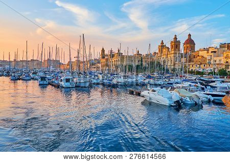 Birgu, Malta - June 18, 2018: The Shipyards With Moored Yachts In Vittoriosa Marina With A View On M