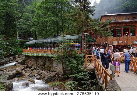 NEAR SUMELA MONASTERY, TRABZON, TURKEY - AUGUST 15, 2008: People on the terrace of restaurant at Sumela monastery. The Monastery is one of the most important historic and touristic venues in Trabzon