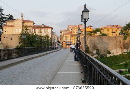 TRABZON, TURKEY - AUGUST 14, 2008: People on Zagnospasa bridge looking at the ancient city walls of Trabzon. Constructed on foundations dating back to the Roman era