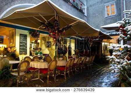 Salzburg,austria- Jan 02,2018: Patrons Sit Inside A Restaurant Enjoying Lunch Early In The Afternoon