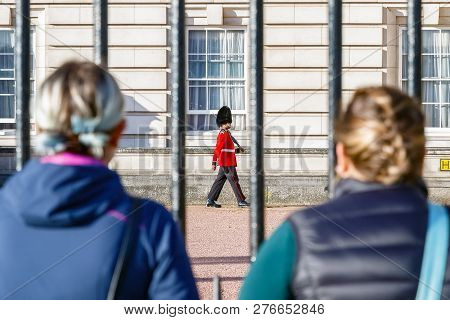 London, Uk - October 3, 2018 - Back View Of Two Tourists Watching A Sentry Of Grenadier Guards Patro