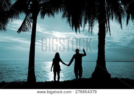 Silhouette Couple Stand Hold Hand In Front Of The Sea Have Coconut Tree, Look Love , So Sweet And Ro
