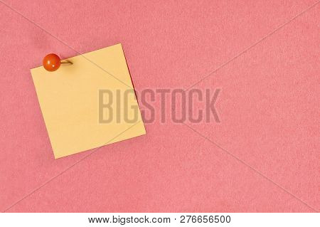 Blank Yellow Note Pad Paper Over Coral Color Background With Free Space For Text. Image Shot From Ab