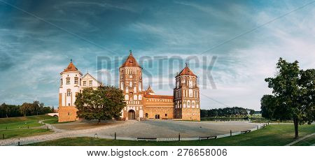 Mir, Belarus. Mir Castle Complex On Blue Sunny Sunset Sky Background. Architectural Ensemble Of Feudalism, Cultural Monument, UNESCO Heritage. Famous Landmark In Summer. Panorama, Panoramic View poster