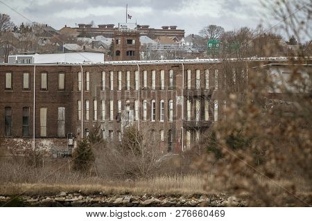 New Bedford, Massachusetts, Usa - January 1, 2019: Decrepit Factory Along New Bedford Waterfront Nor