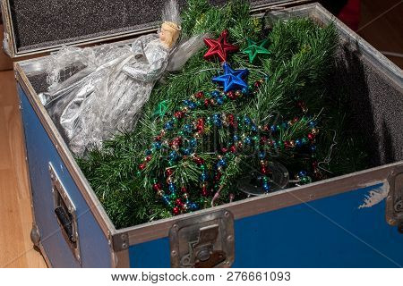 Christmas Tree Decorations Taken Down And Packed Away In Storage. End Or Start Of The Xmas Holiday.