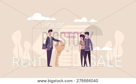 Successful Realtor Holding Key In His Hand And Sells, Rent House To Young Couple Family.estate Agent
