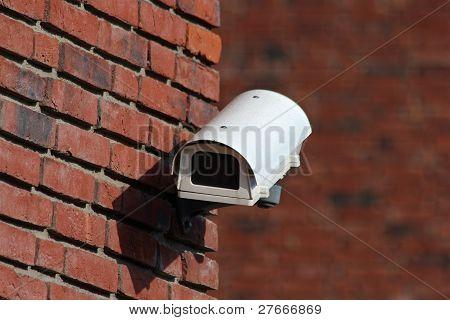 Security Cctv Camera On Brick Wall Facade