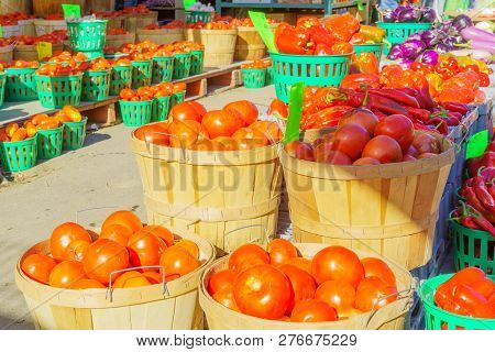 Tomatoes and other vegtables on sale in the Jean-Talon Market Market, Little Italy district, Montreal, Quebec, Canada poster