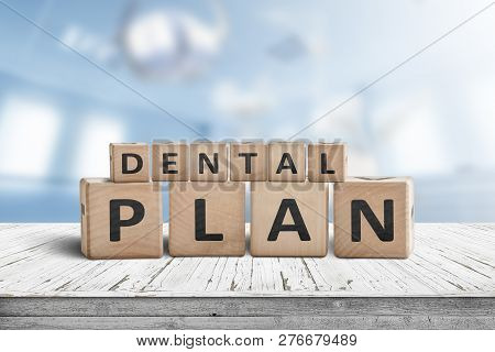 Dental Plan Sign With A Blue Room In The Background With Dentist Equipment