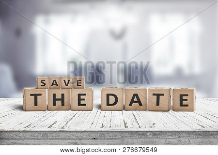 Save The Date Memo Sign On A Wooden Table In A Cozy Bright Room