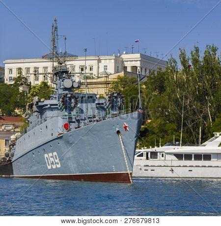 Sevastopol, Crimea - June 23, 2015: View On Russian Navy Warship In Sevastopol Bay. Corvette Aleksan