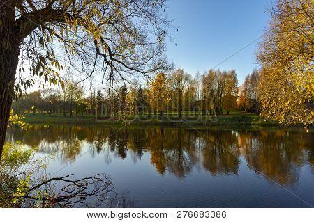 Fall Season Start Idyllic Lake Reflections Of Fall Foliage. Colorful Autumn Foliage Casts Its Reflec