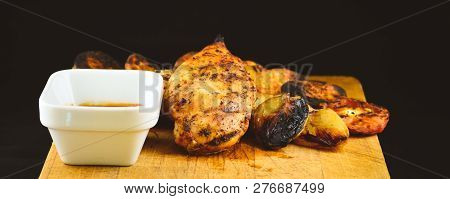 Grilled Chicken Breast On Wooden Platter With Onion.