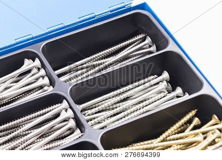 The Photo Shows A Box With Various Screws