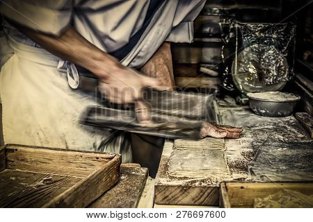 A Man Making Dough And Cutting Noodles With Knife In Kamakura, Japan.