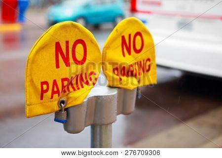 Parking meters with no parking covers on them