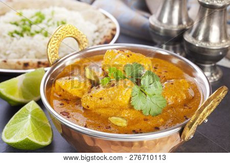 Butter Chicken Curry - Favourite Indian Meal, Butter Chicken With Basmati Rice, Naan Bread And Lime.