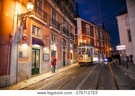 Lisbon, Portugal- Nov 2, 2018: Famous vintage  tram of of Alfama, in the oldest district of the Old Town, at night, Lisbon, Portugal