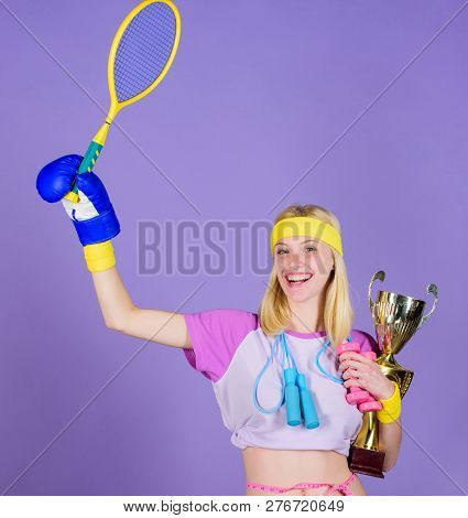Girl Sport Instructor Hold Golden Goblet Of Winner Or Champion. Woman Good In Tennis Jumping Boxing