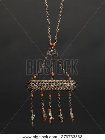 ancient antique earrings with stones on black background. Middle-Asian vintage jewelry poster