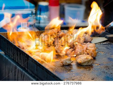 Grilling Chicken Kabobs On Flaming Grill, Chicken Shish Kebab On Bbq Grill In Sauce On Skewers With
