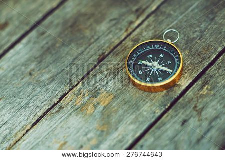 Compass On Wooden Background, Vintage Tone, Journey Planning Concept, Blank Space, Top View, Copy Sp