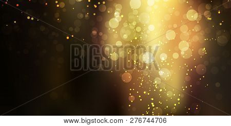 Gold Glittering Sparkle Stardust On Black Background With Bokeh Lights. Festive Golden Background Fo