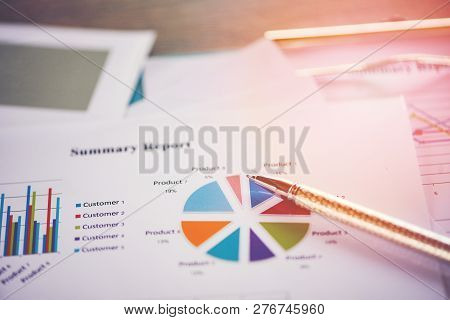 Business Report Chart Preparing Graphs Concept Summary Report In Statistics Circle Pie Chart On Pape