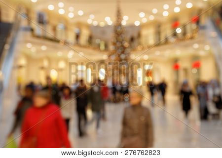 Searching For Christmas Gifts: Blurred Scene With Hurrying Pedestrians In Highly Frequented Shopping