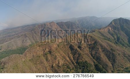 Aerial View Mountain Landscape Mountain Range With High Cliffs. Mountains Covered With Trees And Veg