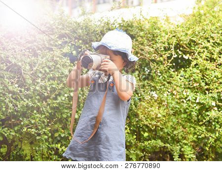 Little Girl Child Photographing - Cute Child Holding Photo Camera In The Garden Park - Young Girl Ta