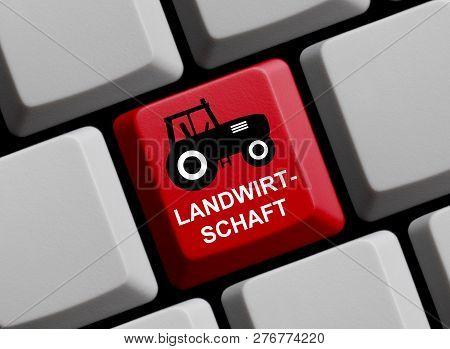 Red Computer Keyboard Showing Farming In German Language