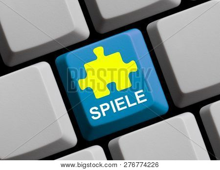Blue Computer Keyboard With Puzzle Showing Games In German Language