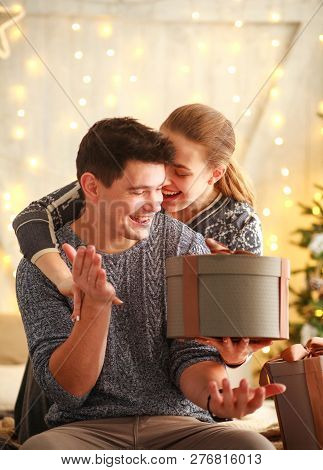 Happy Young Couple In Love Give Gifts Present In Holiday At Home