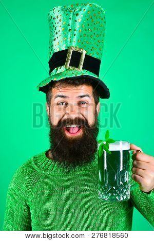 St. Patricks Day. Bearded Man In Leprechaun Hat. Portrait Of Smiling Man With Green Beer. Bearded Le