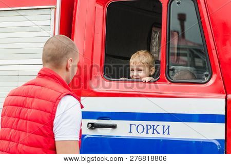 Horki, Belarus - July 25, 2018: The Boy Sits In A Red Car Rescue Service 112 On A Holiday In The Par