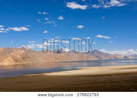 Mountains and Pangong tso (Lake). It is huge lake in Ladakh, altitude 4,350 m (14,270 ft). It is 134 km (83 mi) long and extends from India to Tibet. Leh, Ladakh, Jammu and Kashmir, India poster