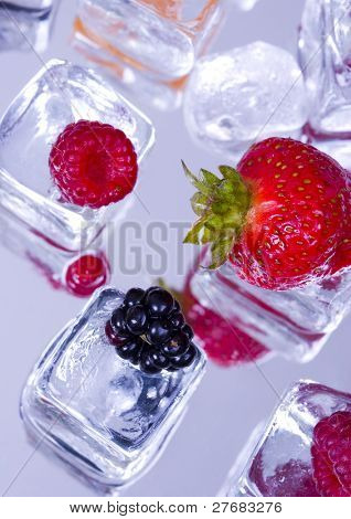 Small fruits among ice cubes