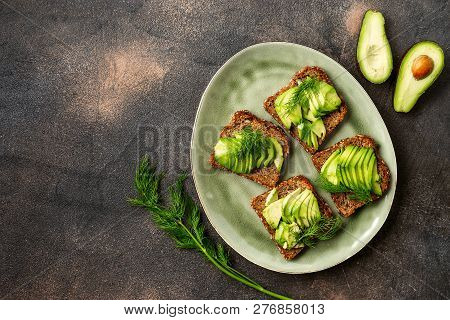 Top View Of Avocado Toasts In A Plate