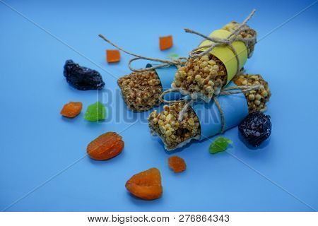 Healthy food, snack from cereal bars of Musli, dried fruits and candied fruits. The concept of diet and sports nutrition. poster