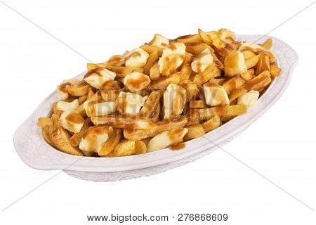 Poutine Plate Isolated On White Background. Meal Cooked With French Fries, Beef Gravy And Curd Chees