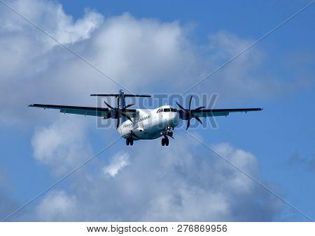 Turboprop Passenger Airplane In Flight Approaching For Landing