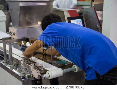 Food Worker Fix And Operate Bakery Making Machine